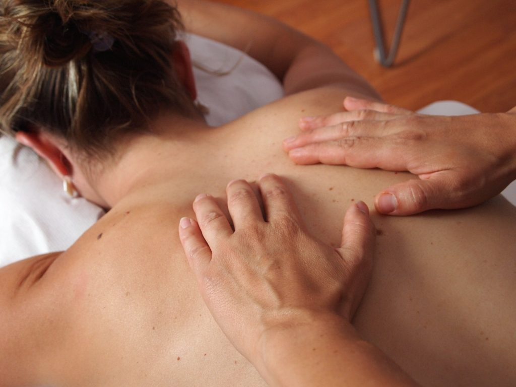 Massage therapist giving deep tissue massage
