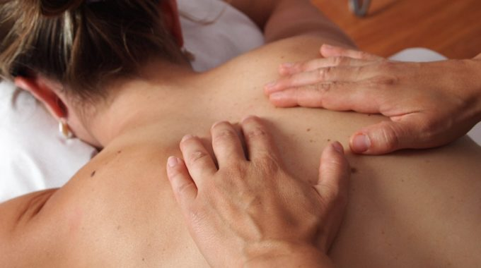Massage Therapist Giving Deep Tissue Massage