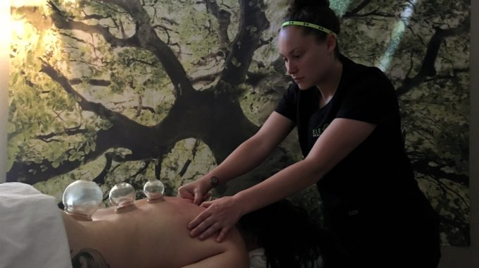 Megan Goodman, Massage Therapist In Bozeman, MT Providing Fire Cupping To A Client